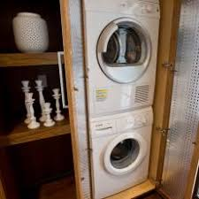 Front loading stacking washer and dryer Maytag Washer Mudroom Cabinet With Stacked Washer And Dryer Yablonovkainfo Photos Hgtv