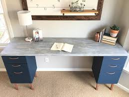 so not only did they makeover the cabinets themselves in this amazing navy and copper look love those legs they made a desk top too
