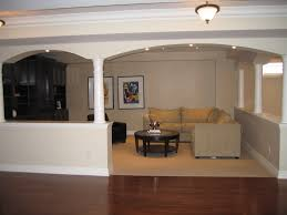 basement finishing design. Cozy Modern Half Wall With Column Living Room Basement Finishing Design L Shape Sectional Sofa And Round Coffee Table On Beige Area Rug Brown Glossy