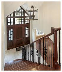 foyer chandeliers in entry farmhouse with vintage lighting next to