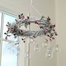 this easy to make diy wreath chandelier will add a special beautiful ideas