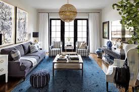 blue and gold botanical art over blue sofa