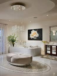 bathrooms master bathroom with white bathtub and modern ottoman also beautiful cascading chandelier master bathroom