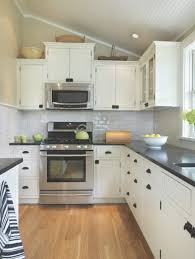 Interesting Kitchen Backsplash White Cabinets Black Countertop regarding  White Kitchen Black Countertops