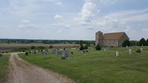 a short ride off the higwhway and a small stretch of gravel road road leads to this isolated church and cemetery i m here to see the grave stone of sarah