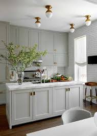 kitchen with gray cabinets with central marble countertop kitchen graycabinets graypaint graykitchencabinets
