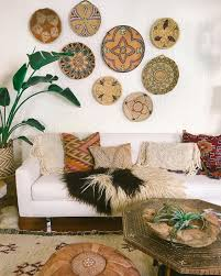 a boho living room is highlighted with bold painted wall baskets
