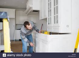 Carpenter Kitchen Cabinet Carpenter Installing Kitchen Cabinet Stock Photo Royalty Free