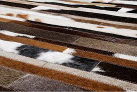 hair on hide detail of white brown and black patchwork cowhide rug designed in stripes