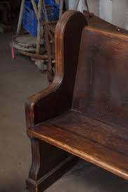 american antique oak church pew with carved cross for