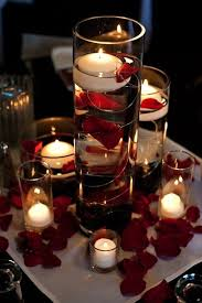 Floating candles and rose petals make easy wedding table decorations. This  would be the center pieces for the tables. this is because of having a  snake bar ...
