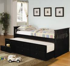 traditional daybed in black finish with trundle and under bed