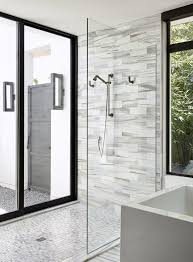 narrow glass shower with modern accents