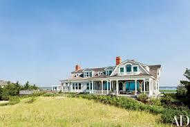 this stunning shingled beach house in the hamptons features modern meets victorian interiors
