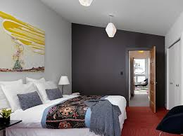 View in gallery Grey accent walls in teh bedroom is predicted to be a hot  design trend this year