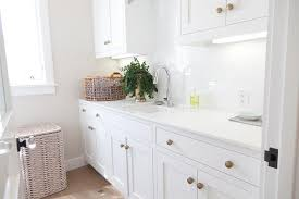 cabinets with knobs. Wonderful With White Laundry Room Cabinets With Brushed Brass Octagon Knobs And With T