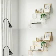new svenshult wall shelf gold colour