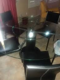 round glass table with black leather base with white stitching 6 black leather chairs 58 inches for in phoenix az offerup