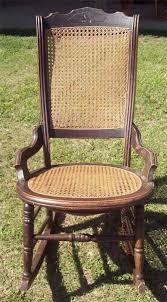 vintage walnut wooden rocking chair cane seat back older nice condition