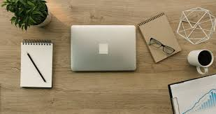 office desk tops. business man working with laptop on office desk opening and putting glasses tops