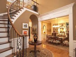 small round entry table design stand on rustic carpet vicinity of staircase near well turned dining table enlightened by floating lamps at home inspiration