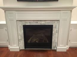 build fireplace surround how to a custom white shaker style cabinets and corian marble facing clean