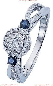 revere 9ct white gold sapphire and 0 33ct diamond halo ring 723 6004