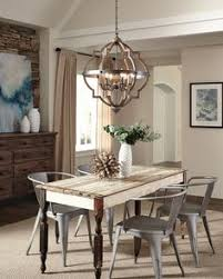 lighting for dining rooms. wood and metal element make this dining space complete find lighting fixture at https for rooms