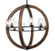 this 8 light chandelier pendant creates a bold statement it has rich auburn stained wood and a distressed black finish outer wooden orbs are 28 in