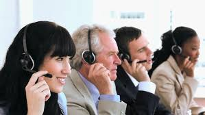 office centre video. joyful call centre agents sitting while wearing headsets in a bright office hd stock footage video o