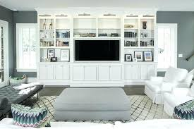 built ins around tv white living room cabinet with nickel picture lights ikea built ins tv built ins around
