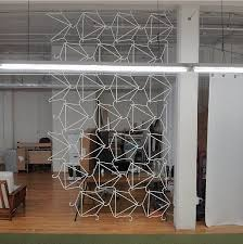 awesome, awesome DIY room divider -- made of simple wire hangers!! -