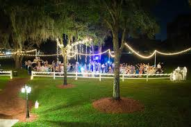 outdoor florida wedding reception under spanish moss covered oak tree with le lights outdoor private estate wedding venue in brandon florida ta