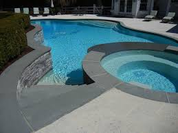curved bluestone pool coping with natural edges