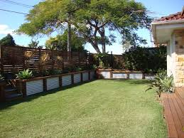 corrugated iron and wood retaining wall