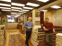 two generations of the family owned oriental rug bazaar at your service at their gastown nasser dibadj owner left and his son daniel