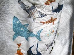 Shoal (the Shark Quilt) | & I particularly like this shark, fussy-cut from Heather Ross's Mendocino  fabric collection. Adamdwight.com