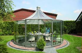 gazebo glass. this round gazebo is encased in glass with a peaked top the has