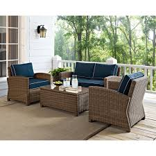 outdoor wicker seating set with navy cushions hover to zoom