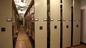 rolling space saving framed art storage racks for museum historical paintings