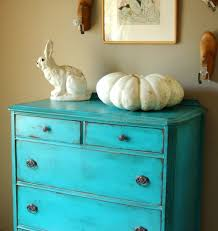 dresser has been painted a stunning turquoise blue and nicely distressed dresser is antique thick wood scroll decorations on bottom blue shabby chic furniture