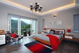 red master bedroom designs. Example Of A Trendy Master Dark Wood Floor Bedroom Design In Bengaluru With Gray Walls Red Designs