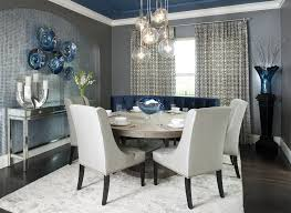 accent wall ideas for modern small dining room ideas with large round table under glass pendant lights and using dark wood flooring types