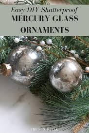 diy faux mercury glass ornaments on evergreen branch