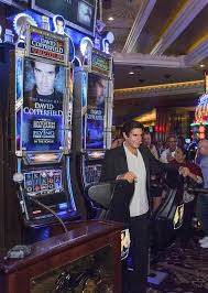 illusionist david copperfield unveils the magic of david  david copperfield poses his bally technologies slot machine the magic of david copperfield at mgm