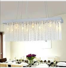 rectangular chandelier dining room rectangle dining room crystal chandelier over dining table with flower centerpiece in