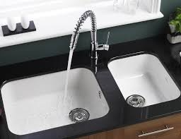 modern double bowls white undermount kitchen sink and single handle faucet on glossy black countertop