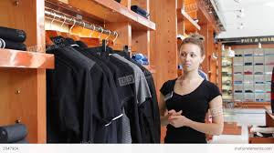 man talking s assistant in clothes shop stock video man talking s assistant in clothes shop stock video footage