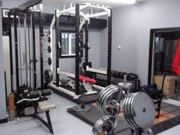 one of a powerlifters garage gym i love those chrome plated discs
