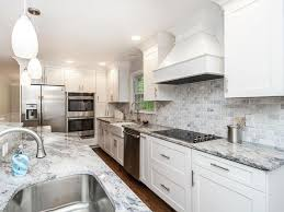 white cabinet kitchen with marble countertoparble tile backsplash with mini pendant lighting